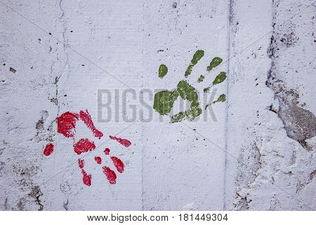White Concrete Wall With Colorful Multi Colored Handprint