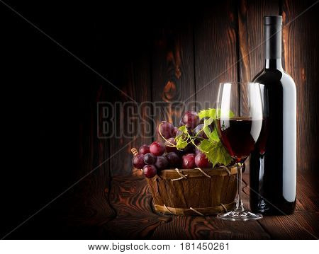 Red wine with a wine glass on wooden background