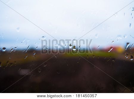 the pouring rain outside the window in summer day