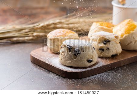 Cones And Icing Sugar On Top And Wood Background