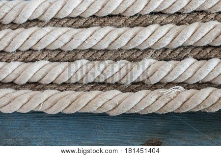 White rope on blank antique blue rustic wooden background