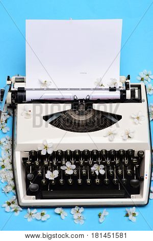 Old Vintage Typewriter With Paper And Spring Blossoming Cherry Flowers