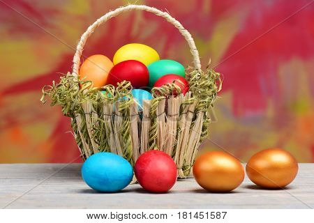 Spring Easter Holiday, Colorful Eggs And Golden Egg In Basket