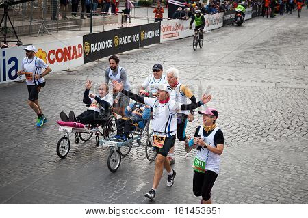 Rome Italy - April 2 2017: the departure of disabled athletes on Via dei Fori Imperiali.