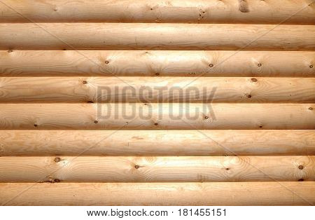 Background of horizontal hewed stooth wooden logs close up