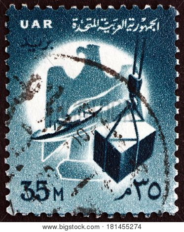 EGYPT - CIRCA 1960: a stamp printed in Egypt shows Eagle Ship and Crate on Hoist circa 1960