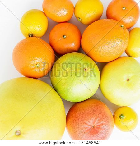 Fresh lemon, orange, mandarin, grapefruit and big sweetie on white background. Flat lay, top view.