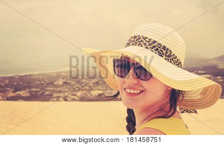 Woman On Vacation Wearing Sunglasses And Beach Hat