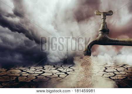 Rustic tap expelling sand in desert setting