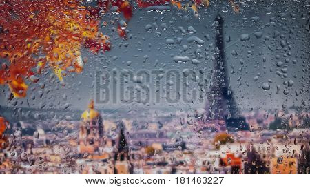 PARIS FRANCE SEPTEMBER  A view of the city from a window from a high point during a rain. Rain drops on glass. Focus on drops