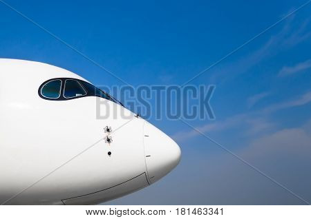 Nose And Cockpit Of Pilots Aircraft On A Background Of Blue Clear Sky