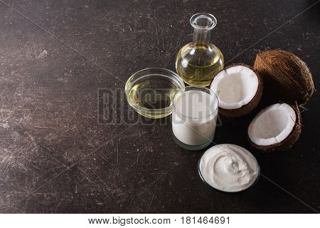 Spa treatments and massages. Coconut and coconut oil for spa on a dark marble background. Exotic large walnut. Personal care. Spa treatments. Spa concept. Spa treatment. Spa massage in the sauna