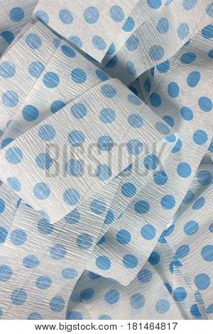 This is a photograph of Blue polka dot Crepe paper streamers