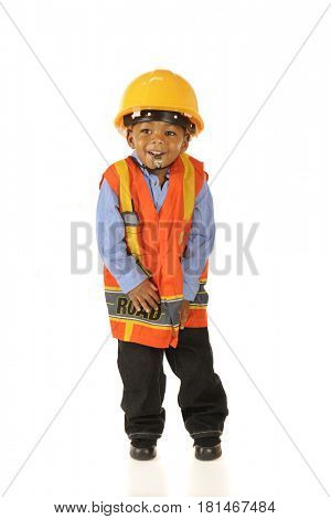 An adorable preschooler happily blowing a whistle while dressed in his road crew gear.  Isolated on white.
