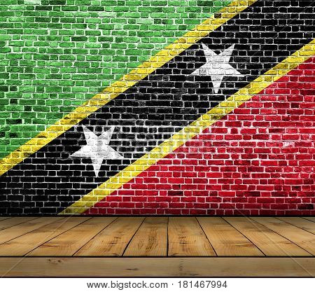 Saint Kittis And Nevis flag painted on brick wall with wooden floor