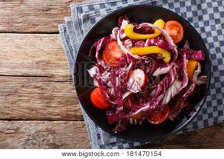 Vegetarian Salad Of Radicchio, Tomatoes And Pepper Closeup. Horizontal Top View