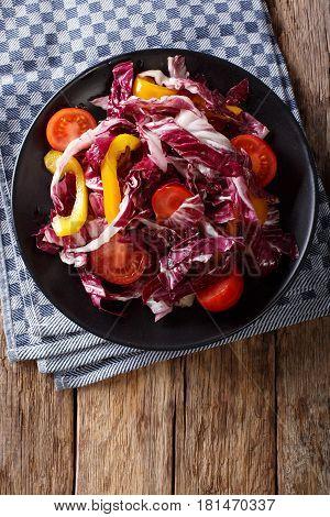 Vegetarian Salad Of Radicchio, Tomatoes And Pepper Closeup. Vertical Top View