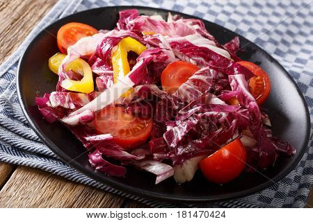 Healthy Radicchio Salad With Tomatoes And Pepper Closeup. Horizontal