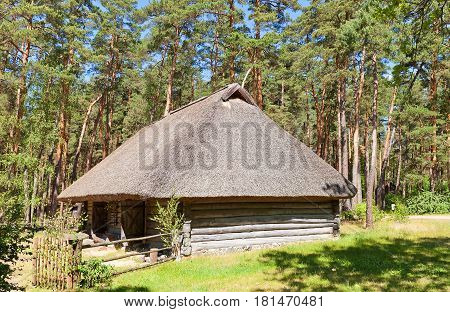 RIGA LATVIA - JUNE 13 2016: Cattle shed (circa 1850s) of Grotkaltini farmstead of Vidzeme ethnic group. Exhibited in Ethnographic Open-Air Museum of Latvia since 1934