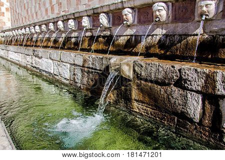 Fountain of the 99 Spouts (Fontana delle 99 cannelle) Historic fountain with 99 jets distribuited along three walls L Aquila Italy