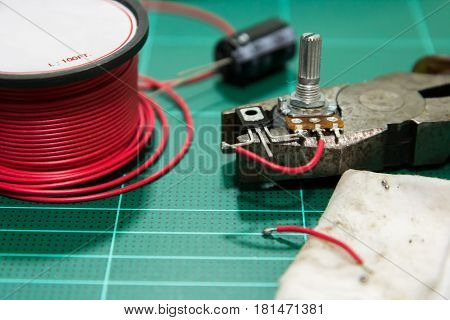 equipment for soldering resistor transistor and capacity.