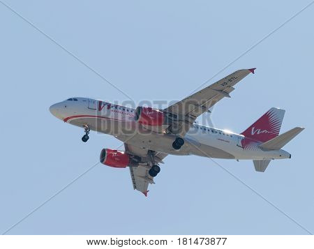 Sochi - April 3 2017: Large passenger aircraft Airbus A319-111 Vim Airlines lands at Sochi airport in the evening against a clear blue sky April 3 2017 Sochi Russia