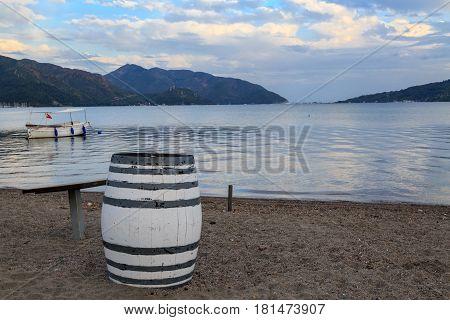 Old barrel on the sand of marmaris beach