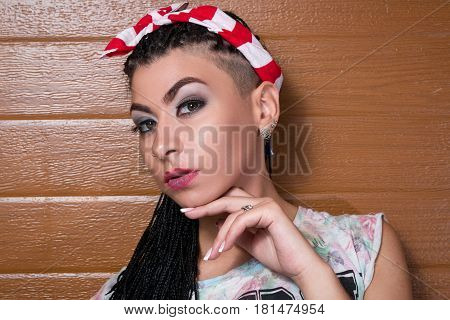 Fashion Large Portrait Of A Stylish Girl With Dreadlocks, An Emotional Look Into The Camera With Bro