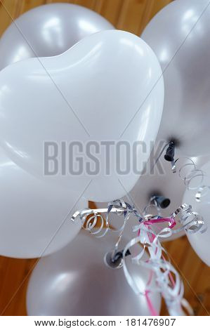 White baloons with heart form and ribbons