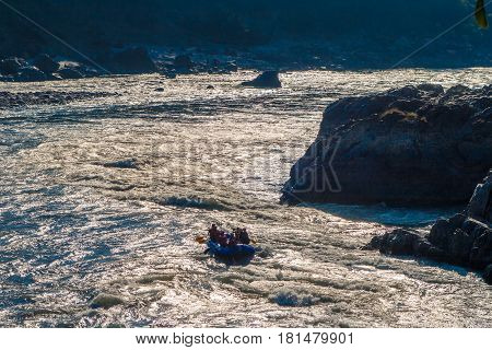 Rafting on the powerful Ganges river in the sun glares in Rishikesh, Uttharakand, North India.