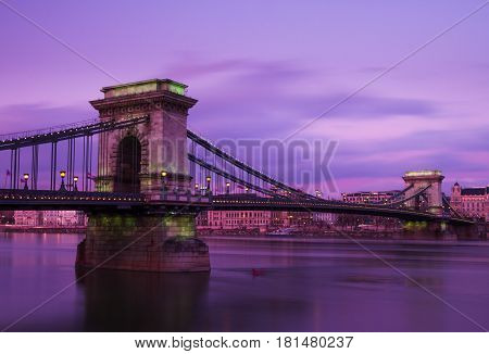 Dusk turns to twilight over Chain Bridge in Budapest one winters evening.