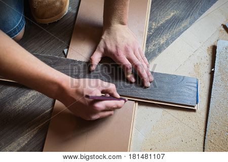 Do makeovers. Sawn board. Make a drawing. Sawdust from a tree. Building tools. Makeovers concept. Makeovers  in home