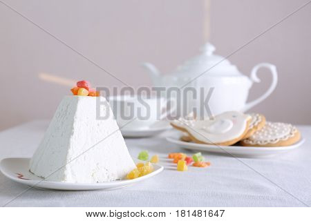 Traditional curd Easter cake with candied fruits on light table