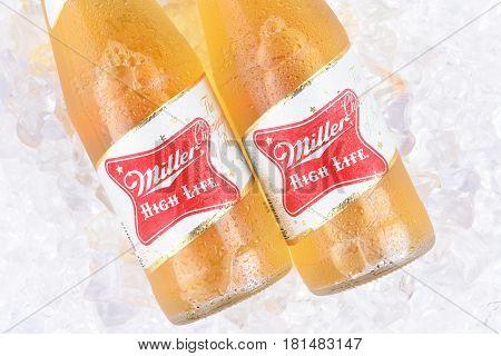 IRVINE CA - APRIL 10 2017: Miller High Life bottles on ice. High Life a pilsner style beer is Millers oldest brand entering the market in 1903