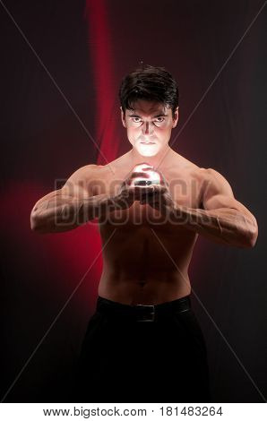 this dramatic photo shows a guy with a light