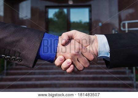 Success in the team. Success in work. Business agreement. Handshake on background Bank. Shake hands with each other. Friendship partners. Success in business. The meeting was a success.