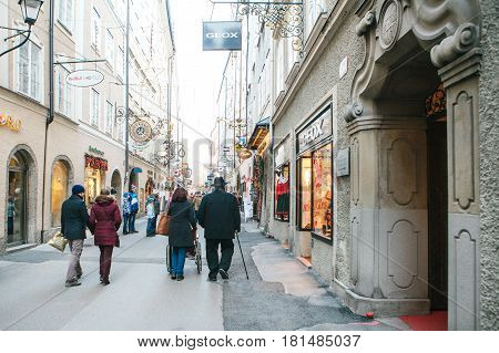 Austria, Salzburg, January 01, 2017: tourists walk around the city. Sightseeing. Vacation, holidays, attractions.