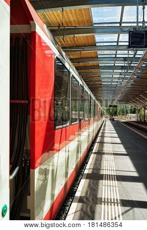 Zermatt, Switzerland - August 24, 2016: Concourse and train at Railway train station in Zermatt Valais canton in Switzerland.