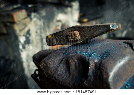 hammer and anvil in blacksmith workshop