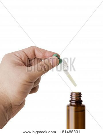 Hand man scientist, doctor keeps the pipette for drop over the container with liquid, medication or chemical substance laboratory. Isolated on white background with clipping path