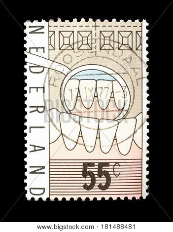 NETHERLANDS - CIRCA 1977 : Cancelled postage stamp printed by Netherlands, that shows Teeth.