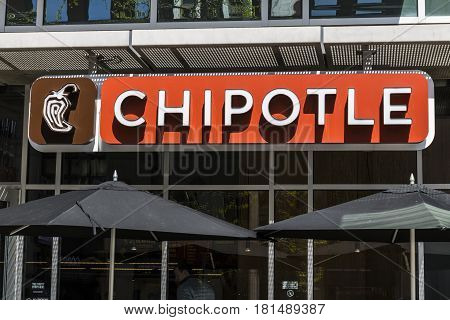 Indianapolis - Circa April 2017: Chipotle Mexican Grill Restaurant. Chipotle is a Chain of Burrito Fast-Food Restaurants XII