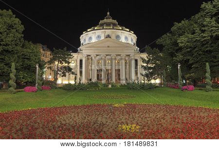 Night image of The Romanian Athenaeum in Bucahrest an important concert hall and a landmark for the city. The building is also home of the George Enescu Philharmonic and the host of the annual George Enescu international music festival.