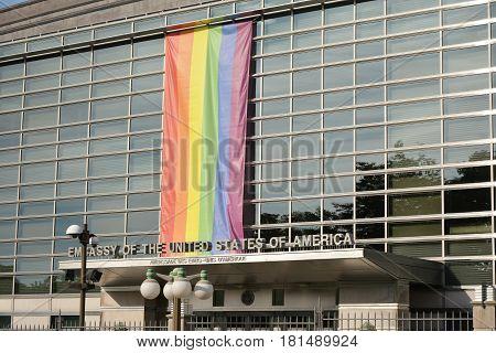 OTTAWA, CANADA - AUGUST 19, 2014: Flag LGBT on USA Embassy in OTTAWA, CANADA. American flag