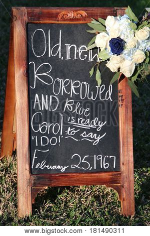 Sign for wedding/anniversary with white and blue flowers