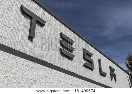 Indianapolis - Circa April 2017: Tesla Service Center. Tesla designs and manufactures the Model S electric sedan III