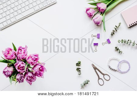 Trendy spring design of office workdesk with blossom on white background top view mock-up