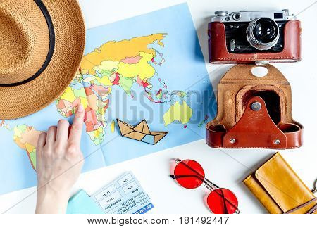 journey planning with tourist outfit and tickets with passport on white table background top view