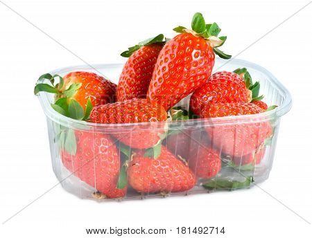 Strawberries in plastic container isolated on a white background