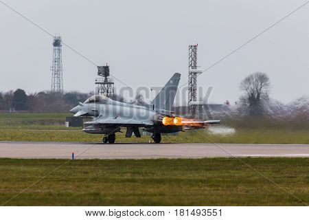 A Typhoon lights up & roars down the runway at RAF Coningsby.